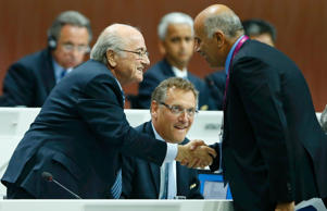 FIFA President Blatter shakes hands with Al Rajoub, President of Palestinian Football Association