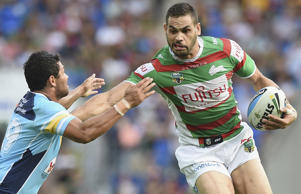 Greg Inglis of the Rabbitohs takes on the defence during the round 12 NRL match between the Gold Coast Titans and the South Sydney Rabbitohs at Cbus Super Stadium.