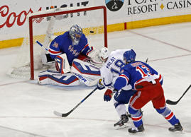Tampa Bay Lightning left wing Ondrej Palat shoots to score past New York Rangers goalie Henrik Lundqvist as right wing Kevin Hayes helped defend during the third period of Game 7 of the Eastern Conference final during the NHL hockey Stanley Cup playoffs on May 29 in New York.