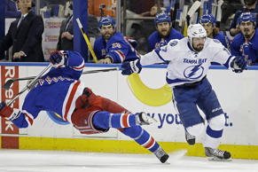 New York Rangers defenseman Dan Boyle falls to the ice as he takes a stick from Tampa Bay Lightning center Alex Killorn during the first period of Game 7 of the Eastern Conference final during the NHL hockey Stanley Cup playoffs on May 29 in New York.