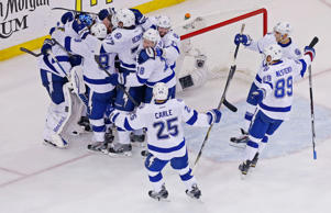 Tampa Bay Lightning goalie Ben Bishop is mobbed by his teammates after defeating the New York Rangers in game seven of the Eastern Conference Final of the 2015 Stanley Cup Playoffs at Madison Square Garden on May 29, 2015 in New York City.
