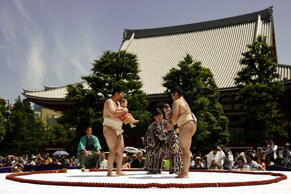 Amateur sumo wrestlers hold babies during a baby crying contest at Sensoji temple in Tokyo May 30, 2015.
