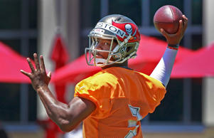 Tampa Bay Buccaneers quarterback Jameis Winston (3) works out for rookie mini camp at One Buc Place.