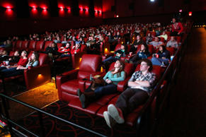 Kerri Donaghue, left,  and Jack Hennessy, right, relax in all powered recliner seats at AMC Movie Theater in Braintree.