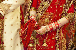 Ornate robes and jewelry worn by the Indian bride and groom on a wedding day.