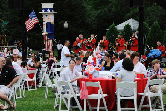 Slide 1 of 13: Families of U.S. servicemen and women attend an Independence Day barbeque on the South Lawn of the White House in Washington July 4, 2011. REUTERS/Jonathan Ernst (UNITED STATES - Tags: POLITICS ANNIVERSARY MILITARY