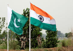 File:Pakistani rangers stand near the Indian (R) and Pakistani national flags during an annual fair near Pakistan border in Chamliyal, 45 km (28 miles) west of Jammu, June 26, 2008.