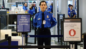 A TSA agent waits for passengers to use the TSA PreCheck lane being implemented by the Transportation Security Administration at Miami International Airport on October 4, 2011 in Miami, Florida.