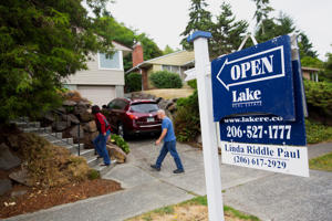 <p>Potential home buyers arrive at an open house in Seattle, Wash.</p>