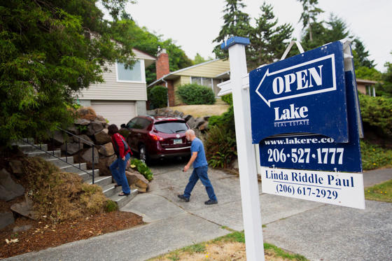 Slide 1 of 11: Potential home buyers arrive at an open house in Seattle, Wash.