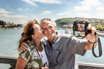 Senior couple taking a self portrait.   Cultura/Dan Brownsword/Getty Images