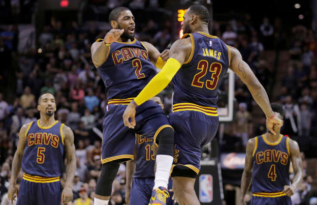 73f2eeb49462 Slide 1 of 34  Cleveland Cavaliers  Kyrie Irving and LeBron James celebrate  during overtime