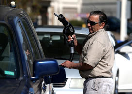 A customer prepares to pump gasoline into his car at an Arco gas station on March 3, 2015 in Mill Valley, California.