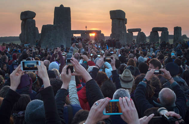 Διαφάνεια 1 από 12: People hug the stones during the summer solstice dawn celebrations after druids, pagans and revellers gathered for the Summer Solstice sunrise at Stonehenge on June 21, 2014 in Wiltshire, England.