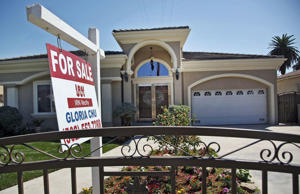 A for sale sign is posted on a home in Monterey Park, Calif. Thursday, Sept. 11, 2014.