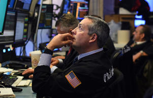 Traders work on the floor of the New York Stock Exchange (NYSE) on October 17, 2014 in New York.