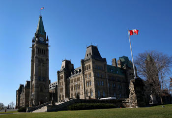 The Centre Block and Peace Tower of the Parliament Buildings stand on Parliament Hill in Ottawa, Ontario, Canada.