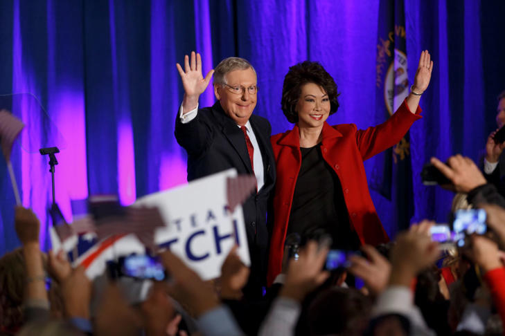 Senate Minority Leader Mitch McConnell of Ky., joined by his wife, former Labor Secretary Elaine Chao, celebrates with his supporters at an election night party in Louisville, Nov. 4, 2014. McConnell won a sixth term in Washington.