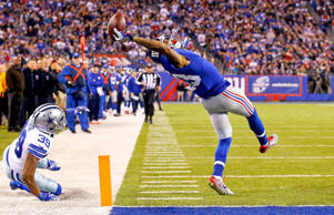 Odell Beckham Jr. of the New York Giants makes a touchdown catch against the Dal...