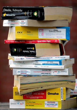 Phone books are stacked in Omaha, Neb., Wednesday, Aug. 6, 2008.