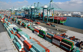 Cargo containers are ready for transportation at the Port of Los Angeles October 27, 2014. A shortage of transportation equipment and possible labor disruptions at the Los Angeles and Long Beach port complexes, the nation's busiest, is delaying shipping containers for up to three weeks, threatening timely delivery to retailers for the holiday season.