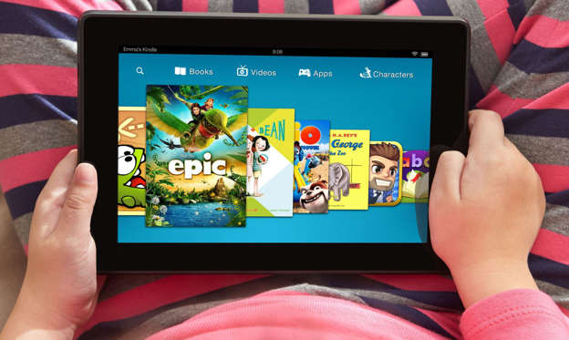 Slide 1 of 40: A child uses an Amazon Kindle Fire HDX tablet, displaying the Kindle FreeTime app, in this undated photo.