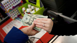 A customer pays for her purchases at the checkout inside a Kmart store in Frankfort, Ky., at the start of the holiday shopping season.