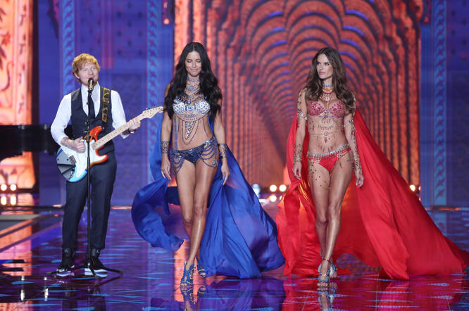 Ed Sheeran performs alongside models Adriana Lima, centre, and Alessandra Ambrosio at the Victoria's Secret fashion show.