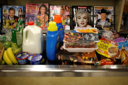 Groceries sits on a conveyor belt in the checkout line at a Publix Super Markets Inc. grocery store in Knoxville, Tennessee, U.S., on Wednesday, March 5, 2014.