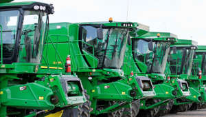 John Deere combines are seen for sale at the Cross Brothers Implement John Deere dealership in Mount Pulaski, Ill.