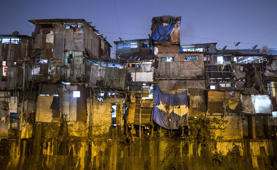 Windows of various shanties in Dharavi, one of Asia's largest slums, are seen in Mumbai January 28, 2015. The rent for a 100 square feet (9.29 square meters) shanty in Dharavi ranges from 2.5 Indian rupees ($ 0.04) per square feet to 3.5 Indian rupees ($ 0.06) per square feet.
