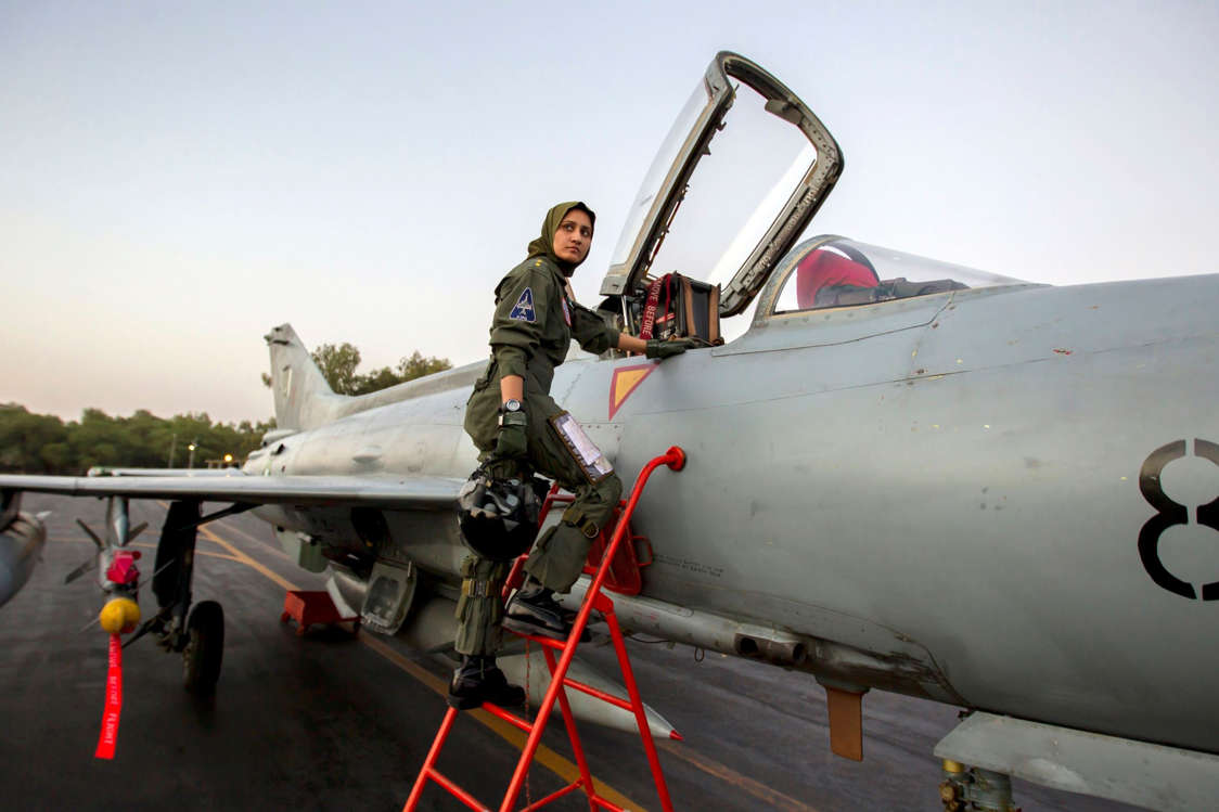 Slide 6 of 24: Ayesha Farooq, 26, Pakistan's only female war-ready fighter pilot, climbs up to a Chinese-made F-7PG fighter jet at Mushaf base in Sargodha, north Pakistan on June 6, 2013. Farooq, from Punjab province's historic city of Bahawalpur is one of 19 women who have become pilots in the Pakistan Air Force over the last decade - there are five other female fighter pilots, but they have yet to take the final tests to qualify for combat.