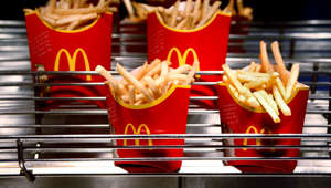 Cartons of McDonald's french fries sit at a restaurant in London, U.K., on Monday, Feb. 1, 2010. Jason Alden/Bloomberg