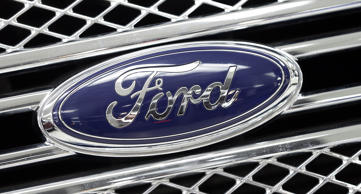 Ford logo on the front grille of a Ford F-150.